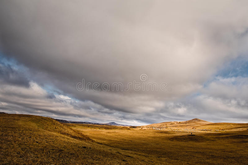 A tornado cloud. Here is the Ulan integration grassland Chinese Inner Mongolia, here is the vast land. In the fall season here very beautiful, golden yellow stock photos