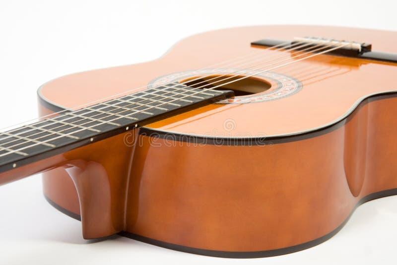 Clouse-op akoestische gitaar. stock afbeelding