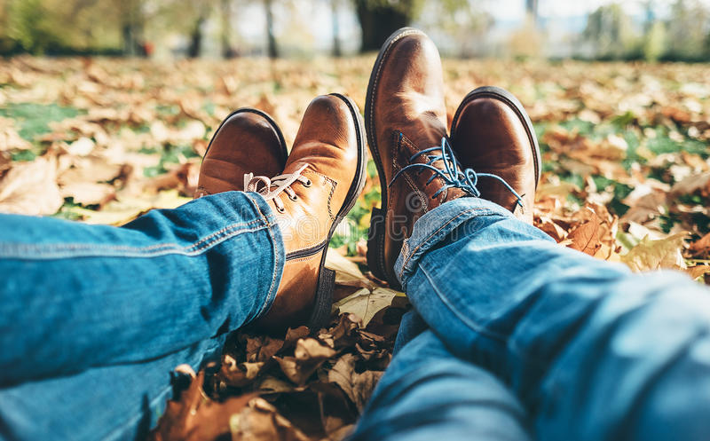 Clouse up image couple in love legs in comfortable laser shoes a stock photography