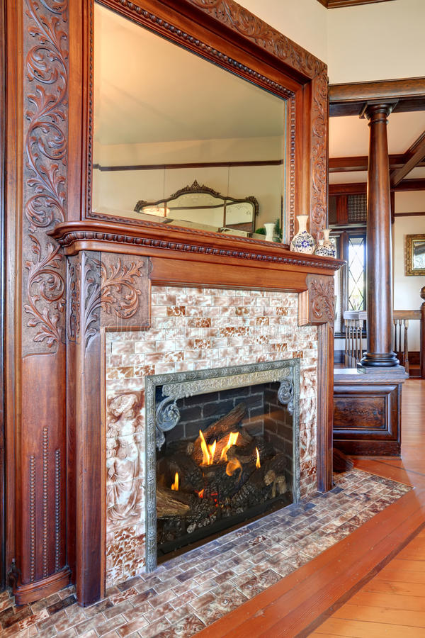 Clouse up view of antique fireplace with decorative tile trim. stock photography