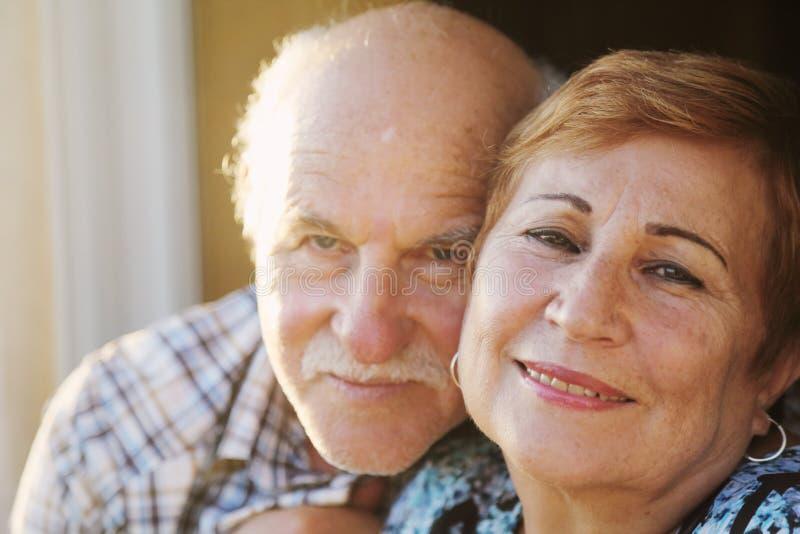 Clouseup portrait of senior couple stock photography
