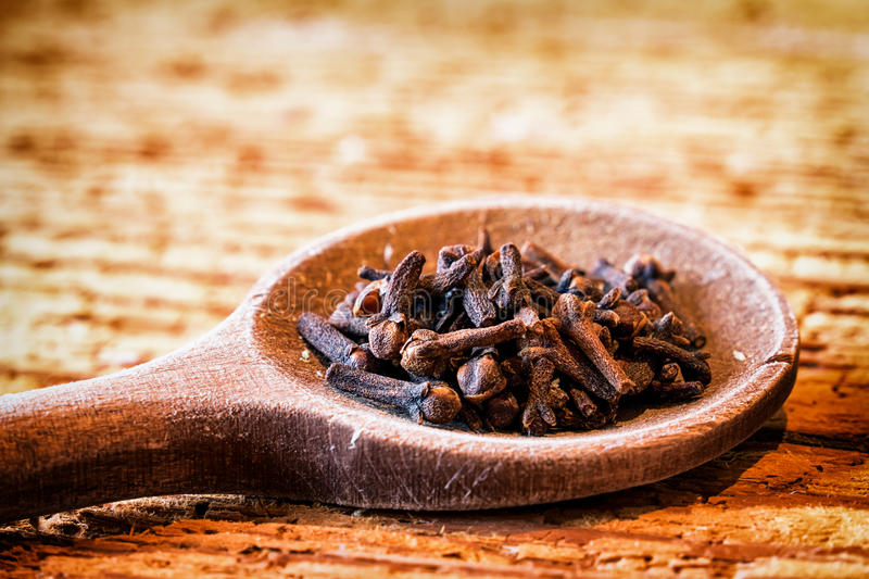 Clove. Incense on an old kitchen spoon - clove royalty free stock images