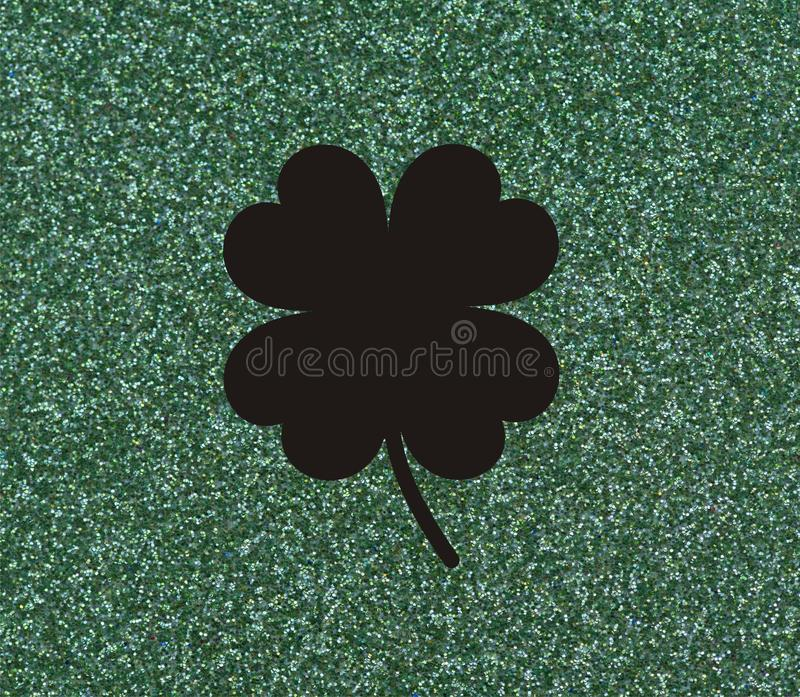 Clover with four leaves, Black on a glittery green background. Illustration stock illustration
