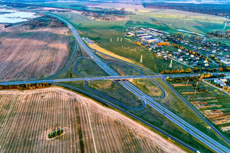 Clover road junction. The connection of the expressway with a secondary road. View from a great height. royalty free stock image