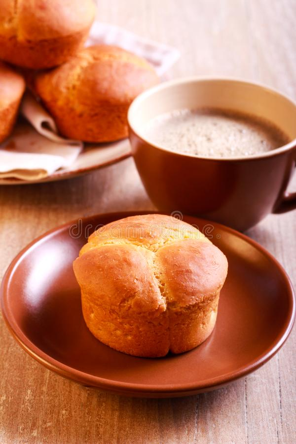 Cloverleaf bran rolls. And cup of coffee royalty free stock photography