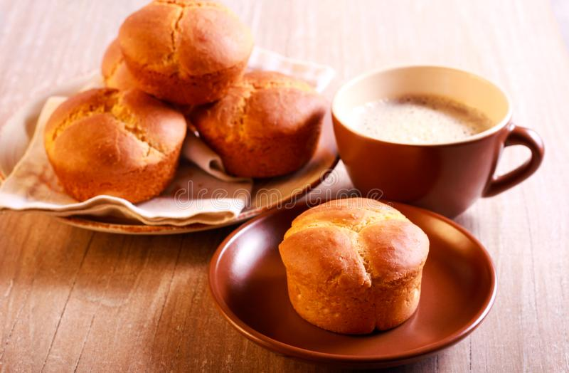 Cloverleaf bran rolls. And cup of coffee stock photos