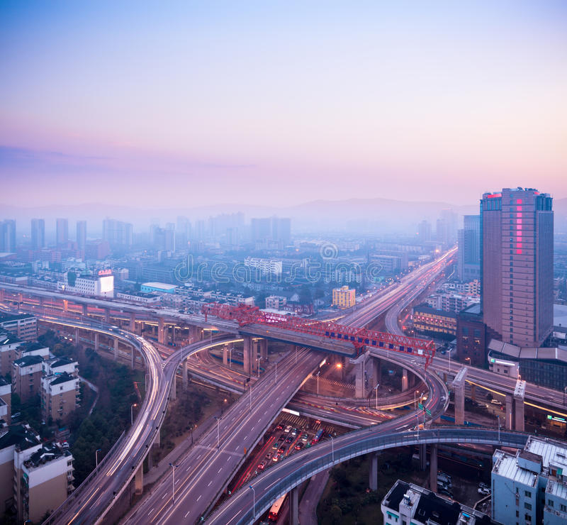 Cloverleaf interchange at dusk. Urban traffic concept royalty free stock images