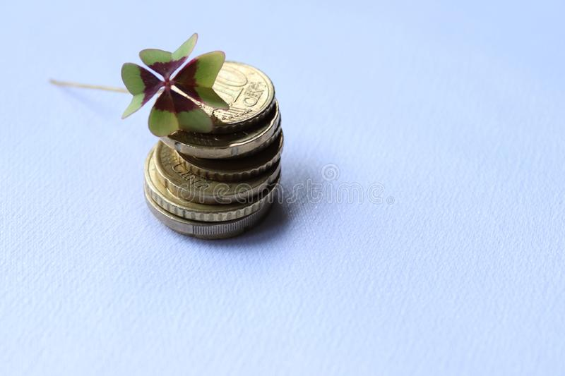 Cloverleaf on euro cents. Cloverleaf on tower of euro coins. Money and happiness royalty free stock images