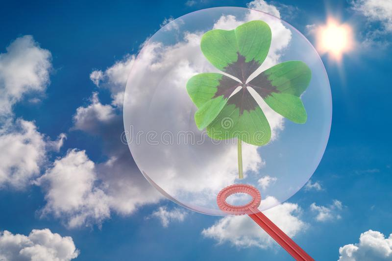 A cloverleaf is surrounded by a soap bubble - 3D-Illustration. A lucky cloverleaf is surrounded by a fragile soap bubble - 3D-Illustration royalty free stock photography