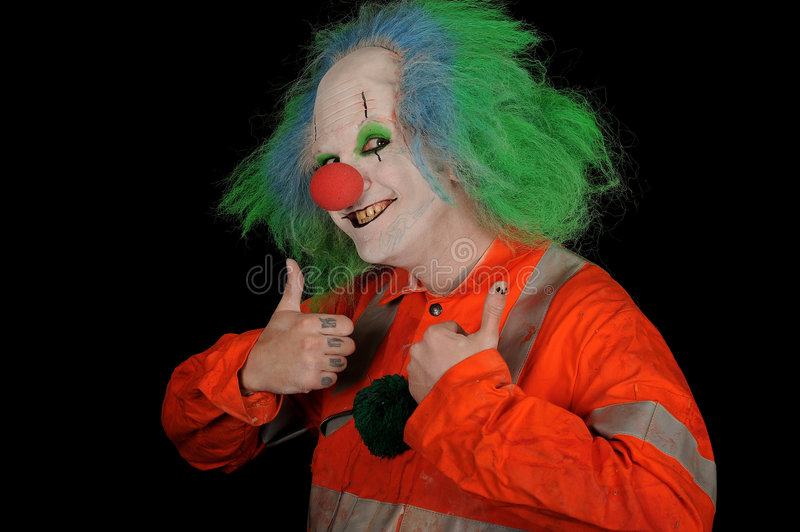Clown. A clown wearing a red suit and blue and green hair with thumbs up royalty free stock photography