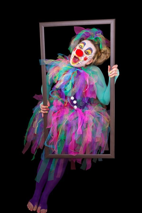 Clown avec le cadre de tableau image libre de droits