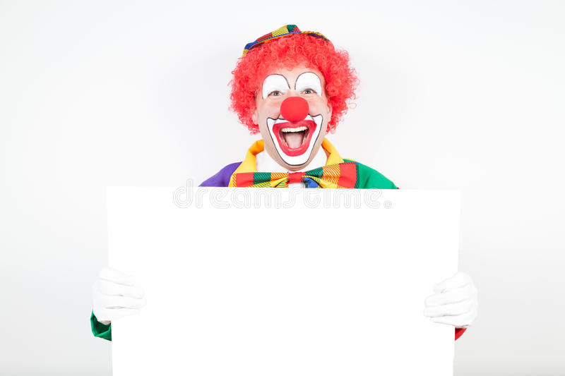 Clown avec le conseil vide photo stock