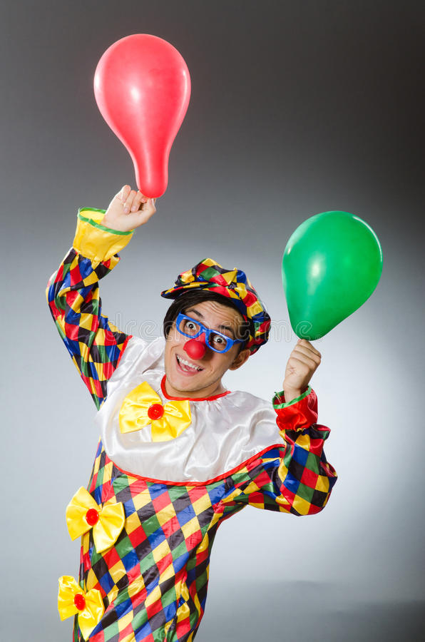 Clown with balloons in funny concept. The clown with balloons in funny concept royalty free stock images