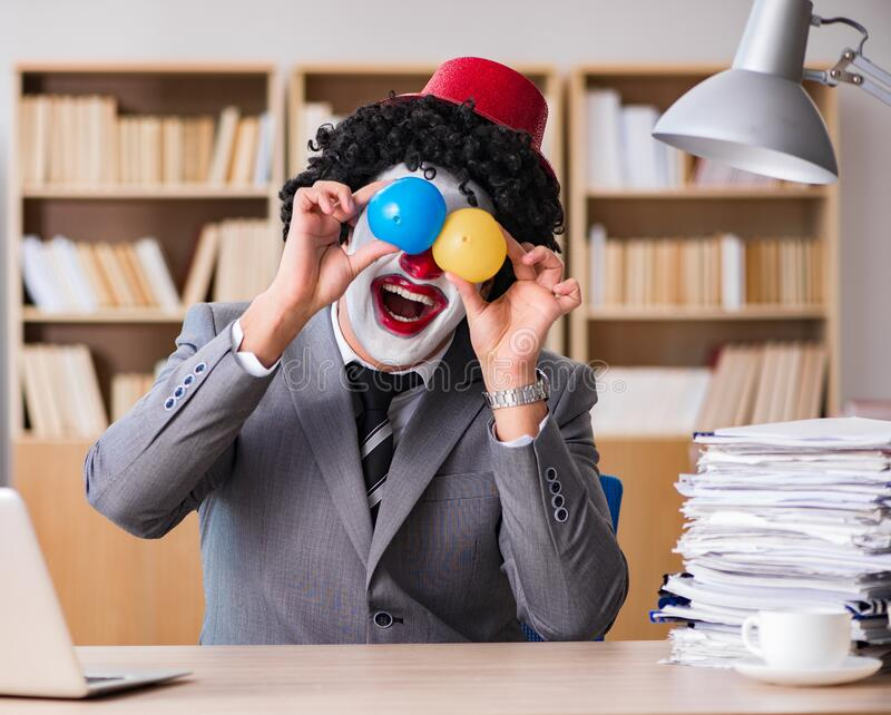 Clown businessman working in the office royalty free stock photo