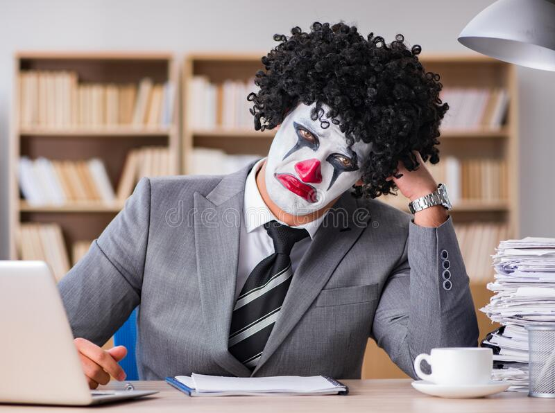 Clown businessman working in the office stock photos