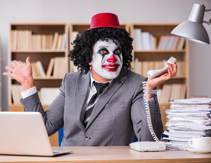 Clown businessman working in the office stock photo