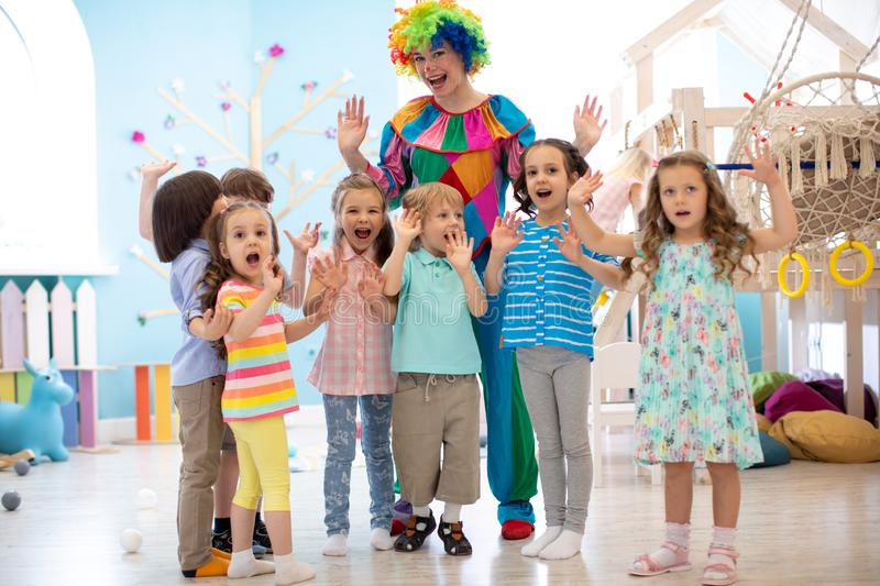 Clown and children playing indoor . Holiday in a children`s club. Games with animator royalty free stock photo