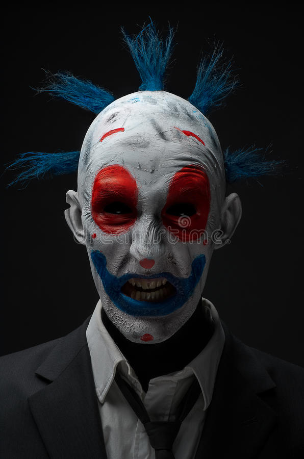 Clown crazy zombies red blue in a jacket. Studio royalty free stock photo