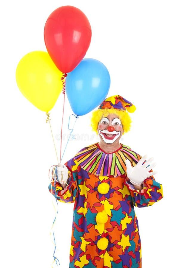 Clown, der mit Ballonen wellenartig bewegt stockfoto