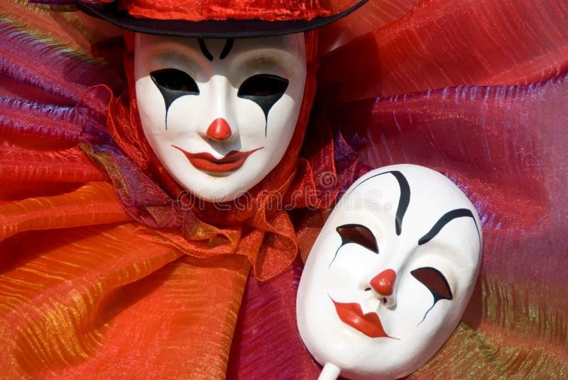 Clown, der seine Schablone anhält stockfoto