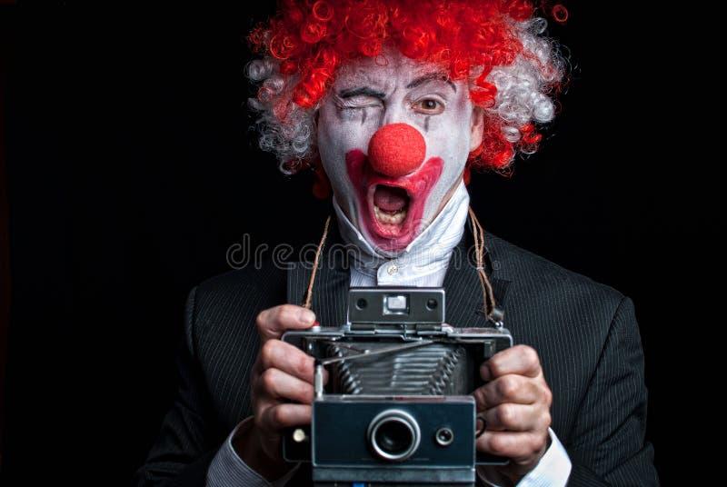 Clown der sofortigen Kamera lustig lizenzfreie stockfotos