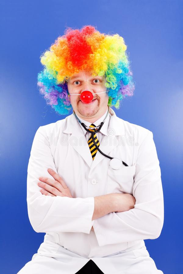 Clown doctor on blue royalty free stock photography