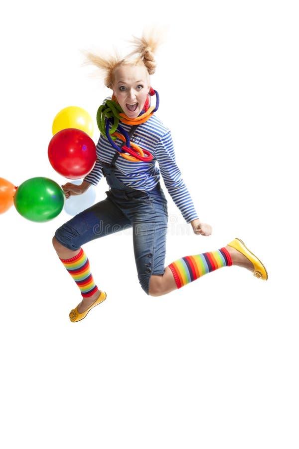 Clown drôle féminin avec des ballons photo libre de droits