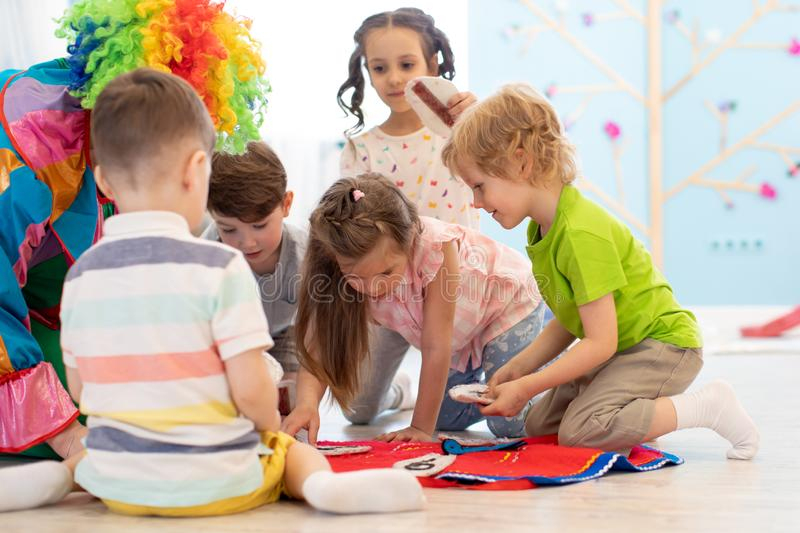 Clown entertains kids group on party royalty free stock image