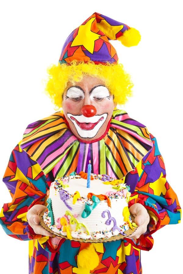 clown för födelsedagblowsstearinljus arkivbilder