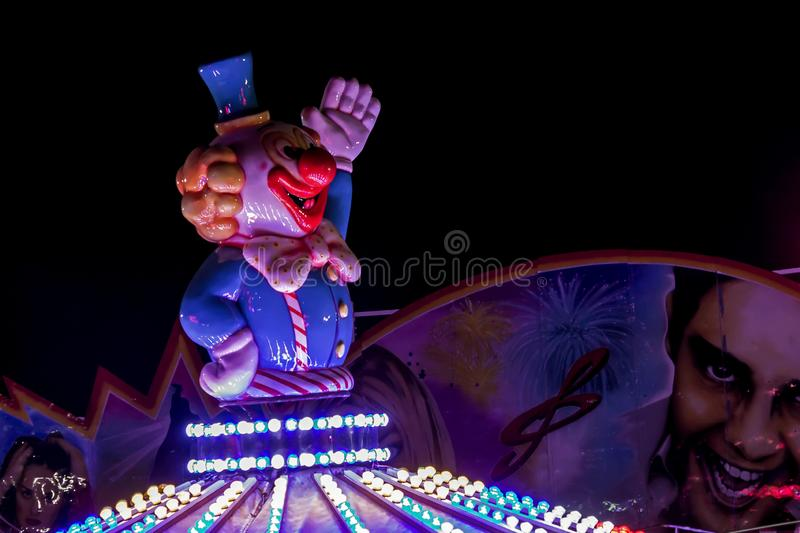 Clown figure at a carousel royalty free stock images