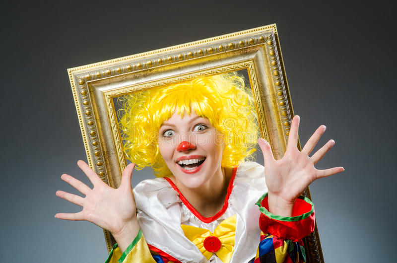 The clown in funny concept on dark background. Clown in funny concept on dark background stock images