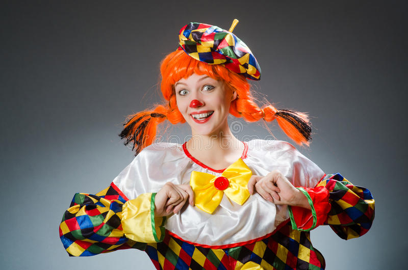 The clown in funny concept on dark background stock images