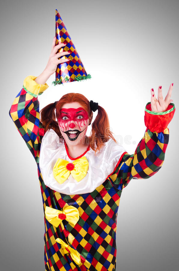Clown in het kostuum stock afbeeldingen