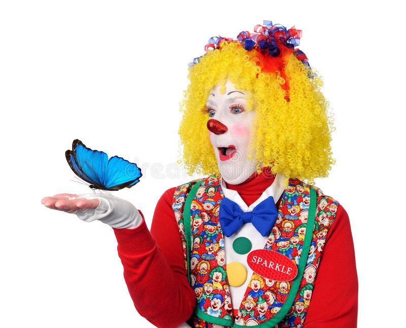 Clown Holding Blue Butterfly. Isolated over white royalty free stock photography