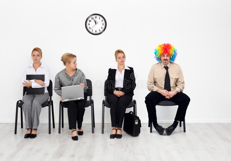 Clown among job candidates royalty free stock image