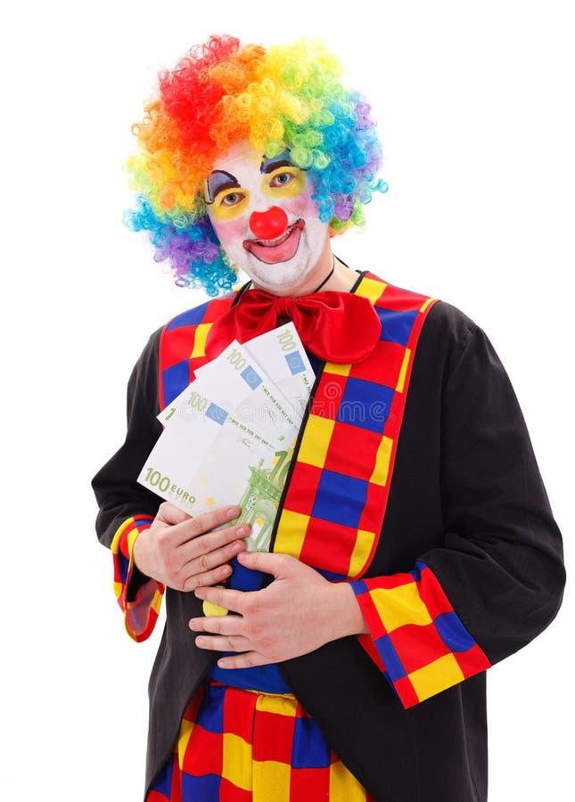 Clown die groot geld tonen stock foto