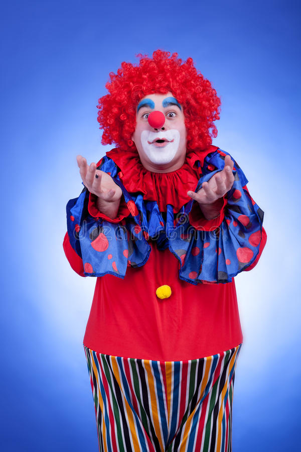 Download Clown Men In Red Costume On Blue Background Stock Image - Image: 40217685