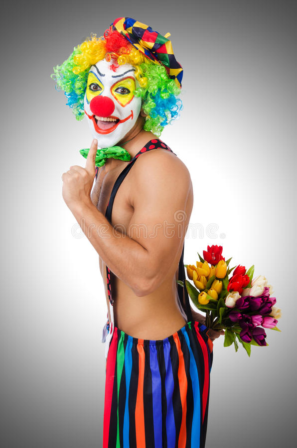 Clown met bloemen stock afbeelding