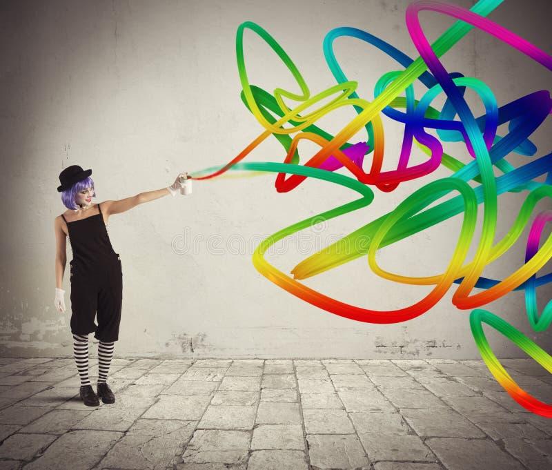 Clown met gekleurde nevel stock afbeeldingen