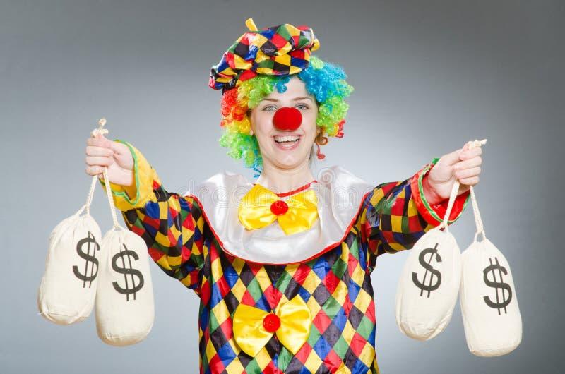 Clown met geldzak in grappig concept royalty-vrije stock foto's