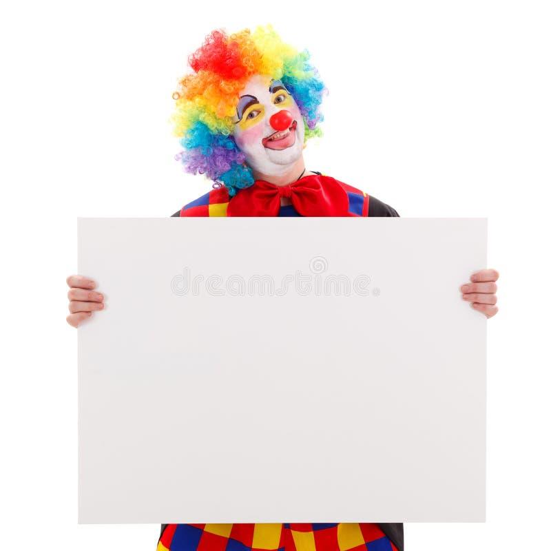 Clown met lege witte raad stock afbeelding