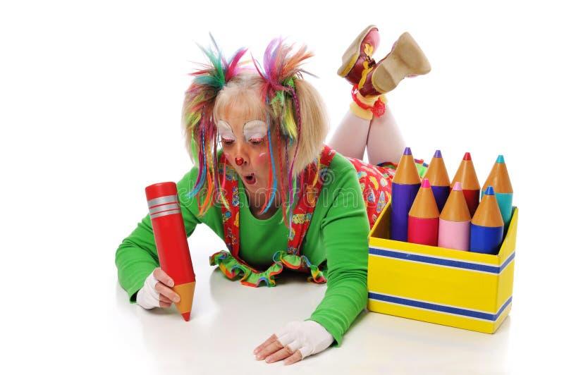 Clown mit Bleistiften stockbilder