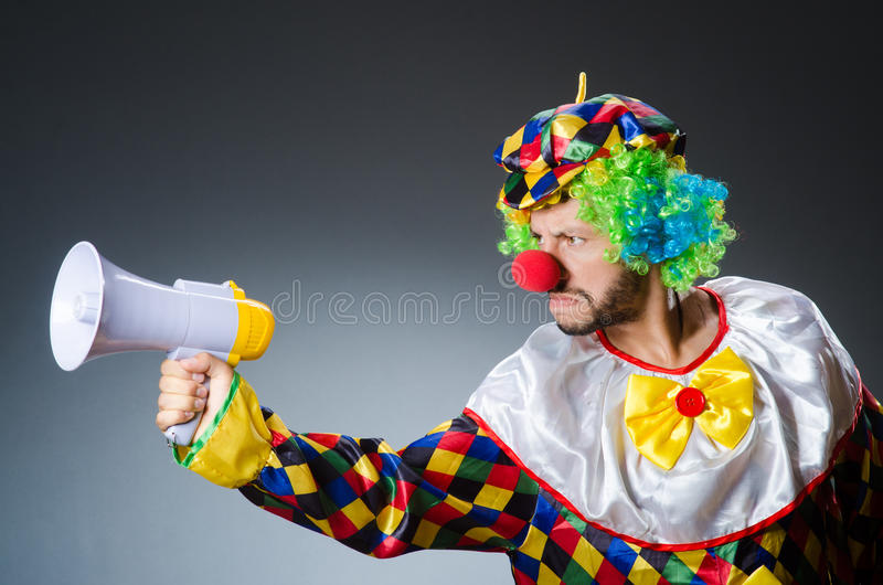 Clown mit loudspealer lizenzfreie stockfotografie