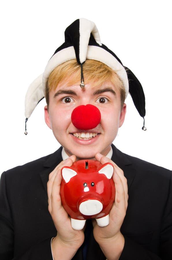 Clown mit piggybank lizenzfreies stockbild