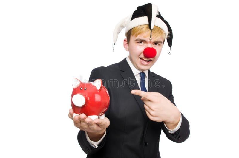 Clown mit piggybank lizenzfreie stockfotos