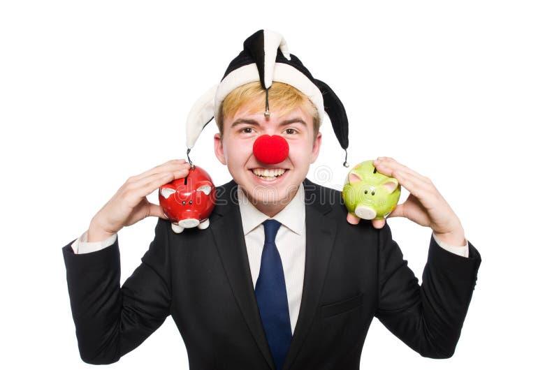 Clown mit piggybank stockfotografie