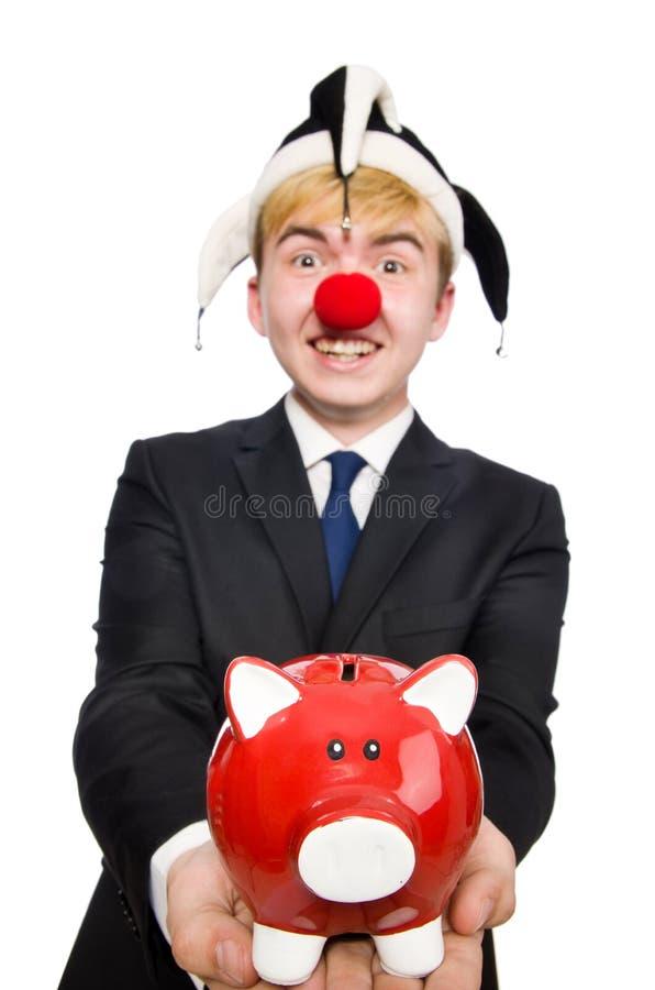 Clown mit piggybank lizenzfreies stockfoto