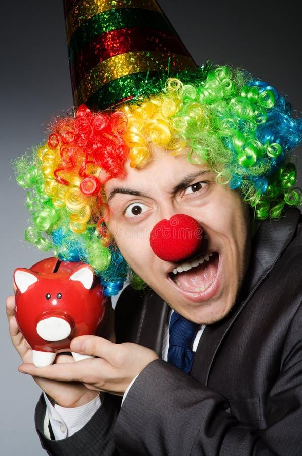 Clown mit piggybank stockbilder