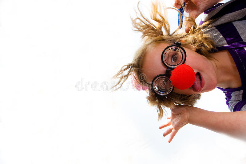 Clown Nosed Kid Looking Down royalty free stock photos