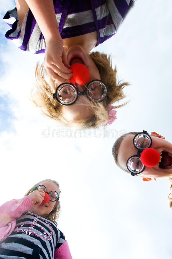 Clown nosed kids stock photography